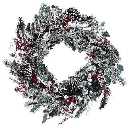 Χριστουγεννιάτικο χιονισμένο στεφάνι στολισμένο με berries 55cm